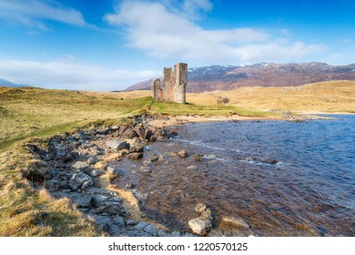 Blue skies over Ardvreck Castle on the NC500 tourist route in the highlands of Scotland