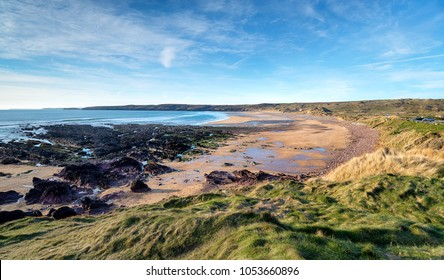 Blue skies over the beach at Freshwater West at Castlemartin in the Pembrokeshire Coast National Park in Wales
