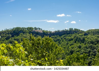 Blue skies are present in a gorge at Red River Gorge in Kentucky