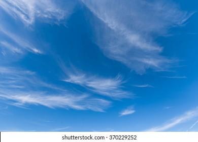Blue skies with wispy clouds