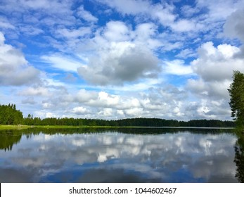 blue sku and white clouds reflecting on the lake