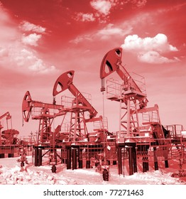 Blue sky above oil field. Red filter