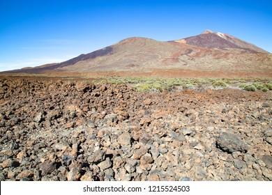 "Blue sky above the vulcan. The National Park ""Vulcan El Teide"" on Tenerife - Canary Islands.  Mountain landscape. Rock debris."
