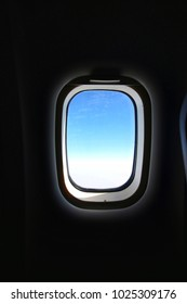 Blue sky in the aircraft window frame