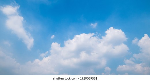 Blue sky background with clouds in summer