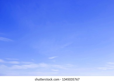 Blue sky background with little soft thin clouds lies at the bottom of photo.