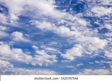 blue sky background with nuves and birds flying