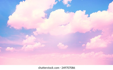 Blue sky background with pink clouds