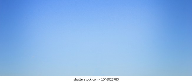 Blue Sky Background, Simple Natural Texture Template of Sky with No Clouds. Backdrop of Pale Light Blue Color, Blur Sky Texture, Blank Wallpaper Poster for Copy Space.