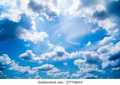 blue sky background with tiny clouds