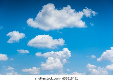 blue sky background with tiny clouds.
