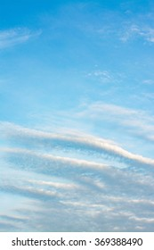 Blue sky background with wave of cloud