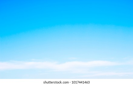Blue sky background and white clouds soft focus, and copy-space.