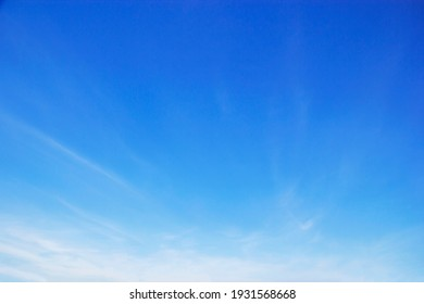 Blue sky background and white clouds soft focus, and copy space horizontal shape - Shutterstock ID 1931568668