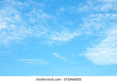 Blue sky background and white clouds soft focus - Shutterstock ID 1933466003