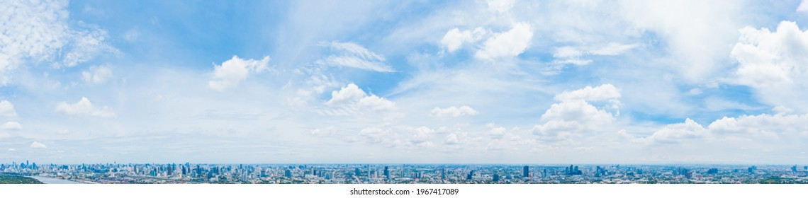 Blue sky background with white clouds, rain clouds and sunlight with lens flare on rainy season or spring day. Panorama view