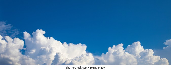 Blue sky background. Wide panorama with cumulus clouds at the bottom of the photo - Shutterstock ID 1958784499