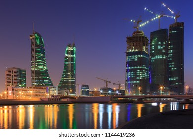 Blue sky and Bahrain skyline with reflection after the sunset.
