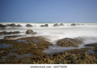 blue sky and beautiful rock on the sea,,this place reef songsong,,and being on the beach malimping banten Indonesia