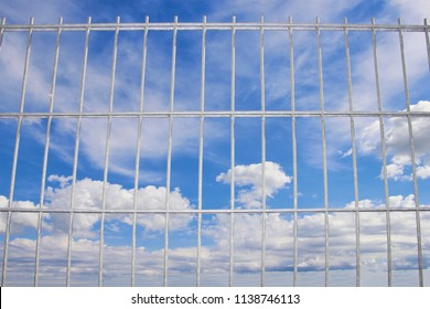 blue sky behind a wire lattice