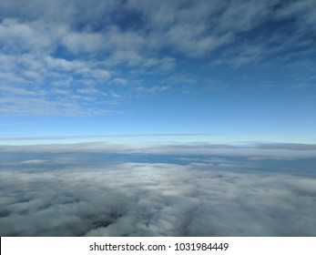 blue sky beyond the horizon of clouds