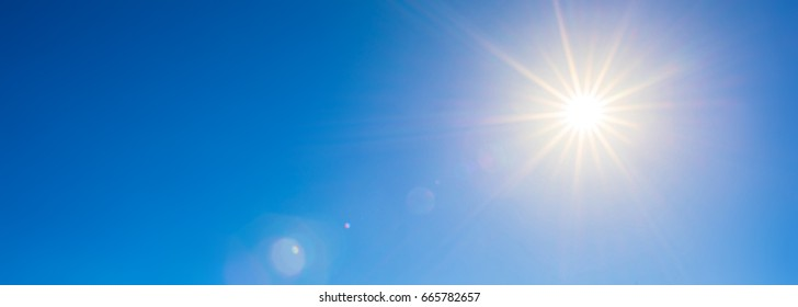 Blue sky with bright sun