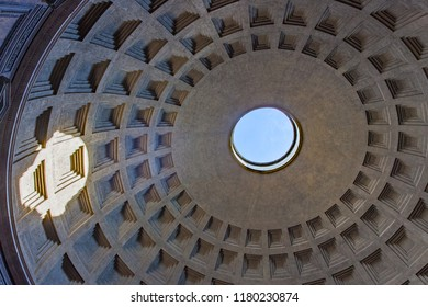 Blue sky and circle of light visible through hole in dome of Pantheon in Rome