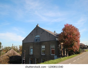 Blue sky with cirrus clouds above the meadows at the dyke along river Hollandsche IJssel in Nieuwerkerk aan den IJssel in the Netherlands.