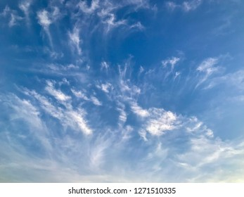 Blue sky with cloud background. Selective focus.