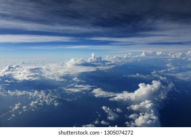 blue sky with cloud over sea from airplane view