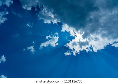 Blue sky with cloud and sun ray.