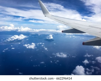 blue sky and cloud view through aircraft windows over the sea, bunaken  indonesia