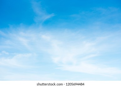 blue sky and cloud.blue sky back ground. Sky on a bright day. The softness of the clouds and the brightness of the sky. Light blue background.Bright blue background. Relaxing feeling like being in the - Shutterstock ID 1205694484