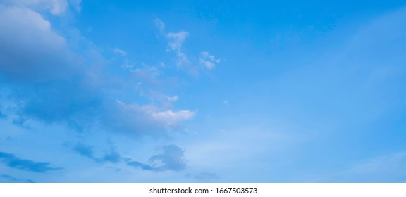 The blue sky with clouds as the blue backdrop in the air The nature of the blue sky with clouds in the morning, the blue sky with white, soft clouds