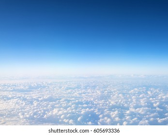 Blue sky with clouds background with copy space.View from airplane.