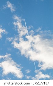 blue sky with clouds and condensation trail, holiday voyage