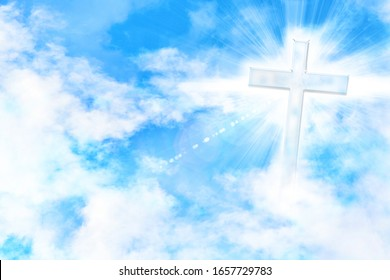 Blue sky with clouds and cross with glare and doves flying. Horizontal composition