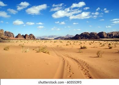 Blue sky, clouds and desert in Wadi Rum, Jordan