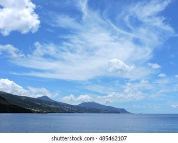 Blue sky with clouds and the distance island of Dominica, Caribbean