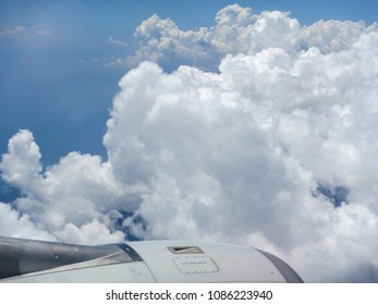 blue sky with clouds from flying plane