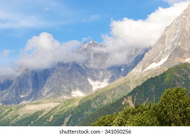 Blue Sky, Clouds, Mountain Peaks and Hills