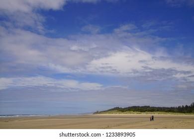 Blue sky with clouds on Ona beach, Newport, Oregon