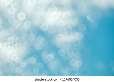 Blue Sky and Clouds on Sunny Day with Bokeh and Flair Lighting