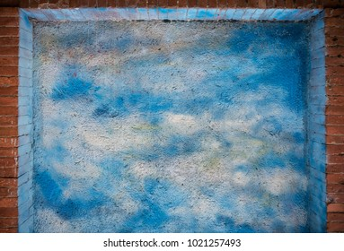 Blue sky and clouds over brick wall texture or background