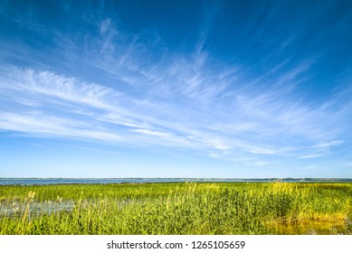 Blue sky with clouds over Lake Razna