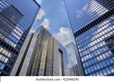 Blue sky and clouds reflect in the windows of downtown office building in Toronto Canada.