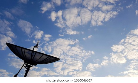 Blue sky with clouds and satellite dishes Soft focus.Use as illustration for presentation.