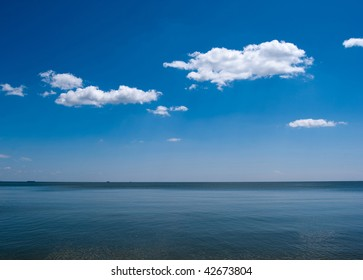 Blue sky with clouds and the sea (original)