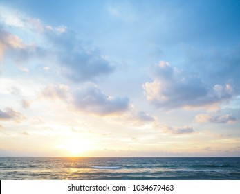 blue sky with clouds and sea, sunset