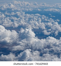 blue sky with clouds seen from a plane useful as a background